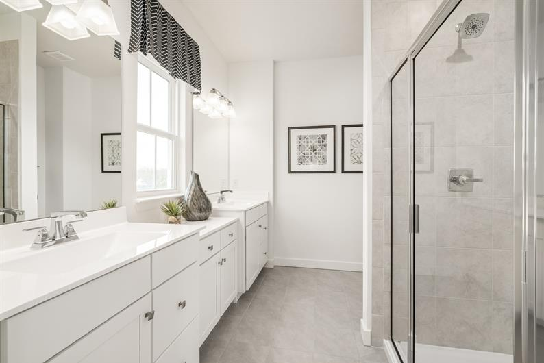 PRIVATE EN SUITE WITH DUAL VANITIES FOR EASY MORNING ROUTINES