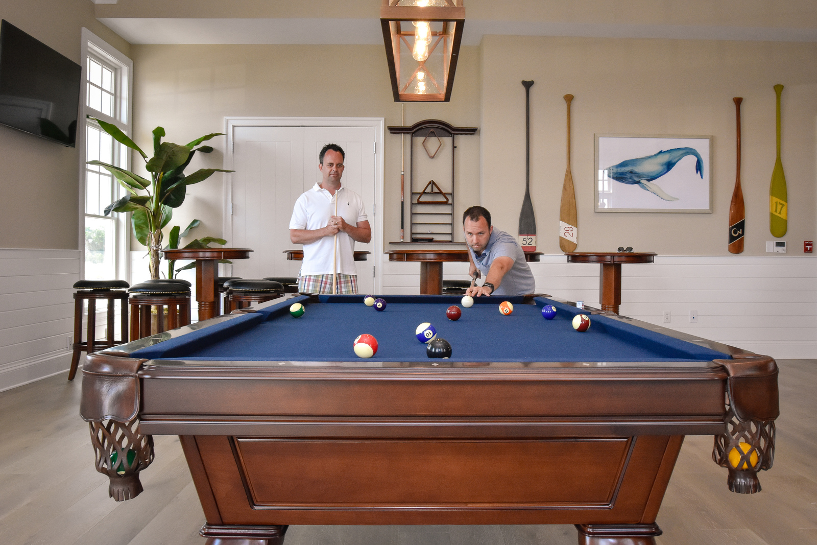 Play a few rounds on the community pool tables.