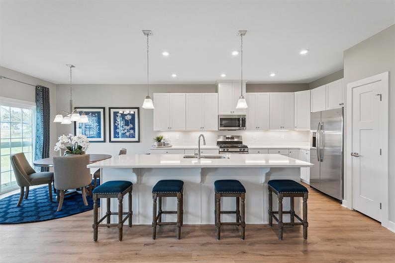 WIDE-OPEN KITCHENS WITH SPACIOUS ISLANDS AND PLENTY OF CABINET SPACE