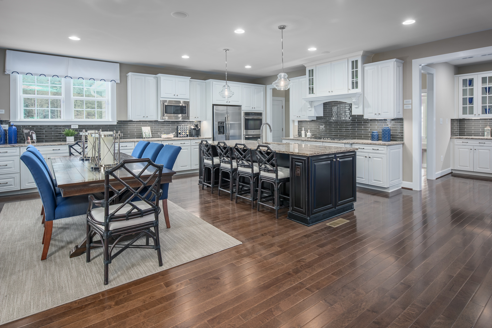 Expansive Kitchens are perfect for hosting family gatherings with the included double wall oven, Chef's hood, and stainless steel appliances