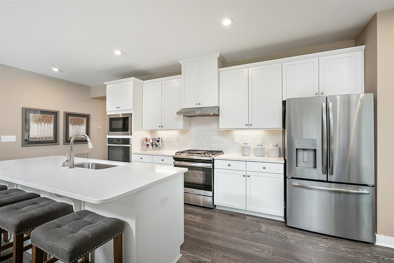 A spacious kitchen and large island create a chef's oasis