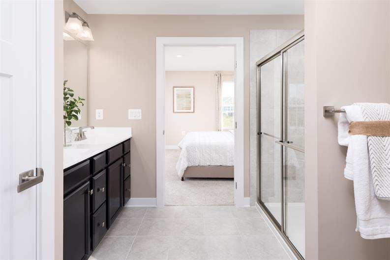 Spacious En-Suite Bath With Seated Shower