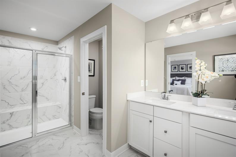 MORNING ROUTINES MADE EASY WITH DUAL VANITIES IN OWNER'S BATH