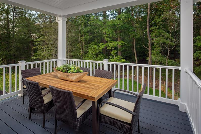 ENJOY AN OUTDOOR OASIS WITH SCENIC WOODED AND POND VIEWS