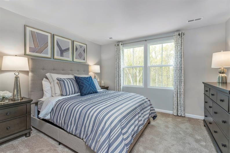 Spacious owner's suite includes an en suite and walk-in closet