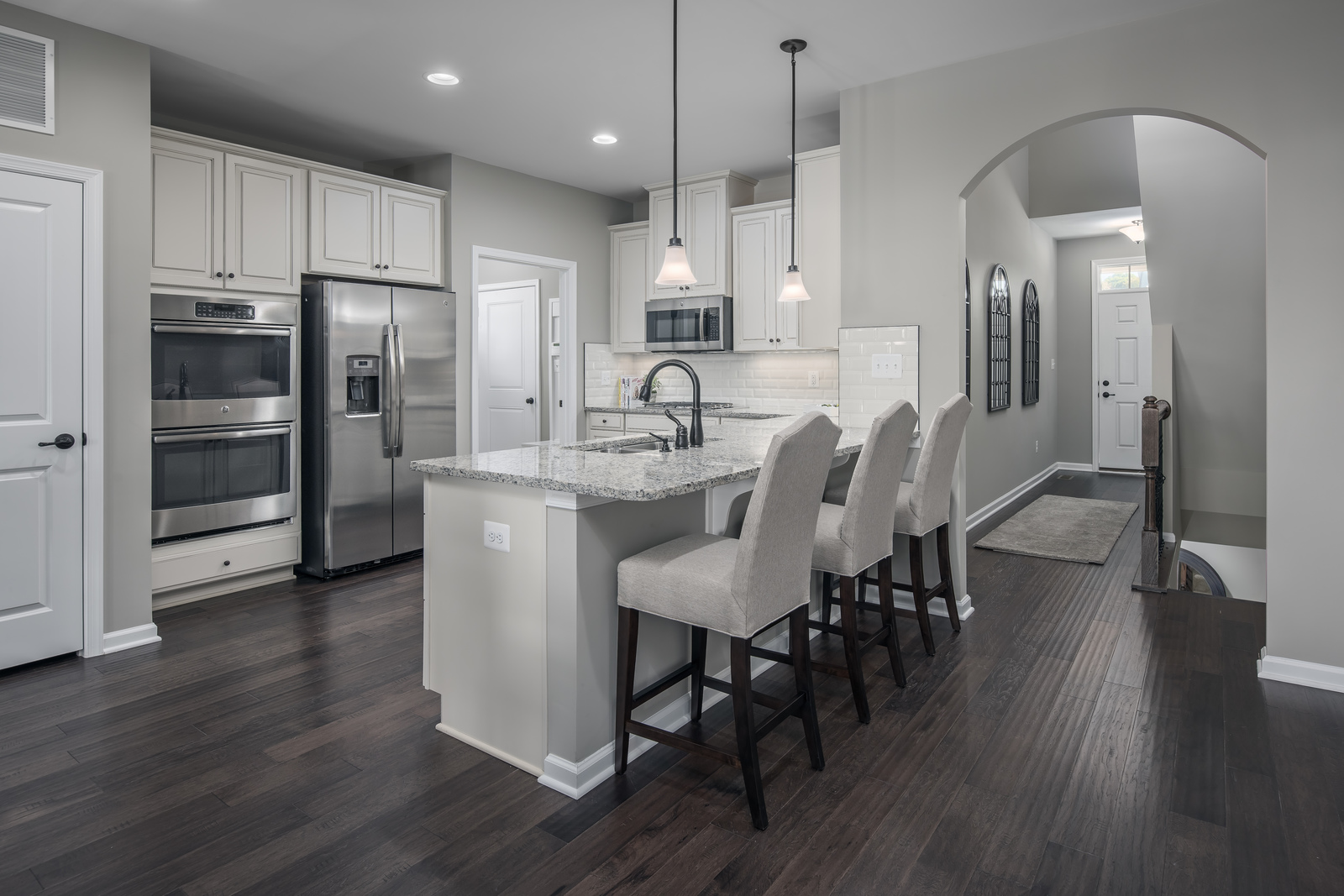 You'll love cooking and entertaining in an expansive kitchen full of cabinets for storage and counterspace galore!