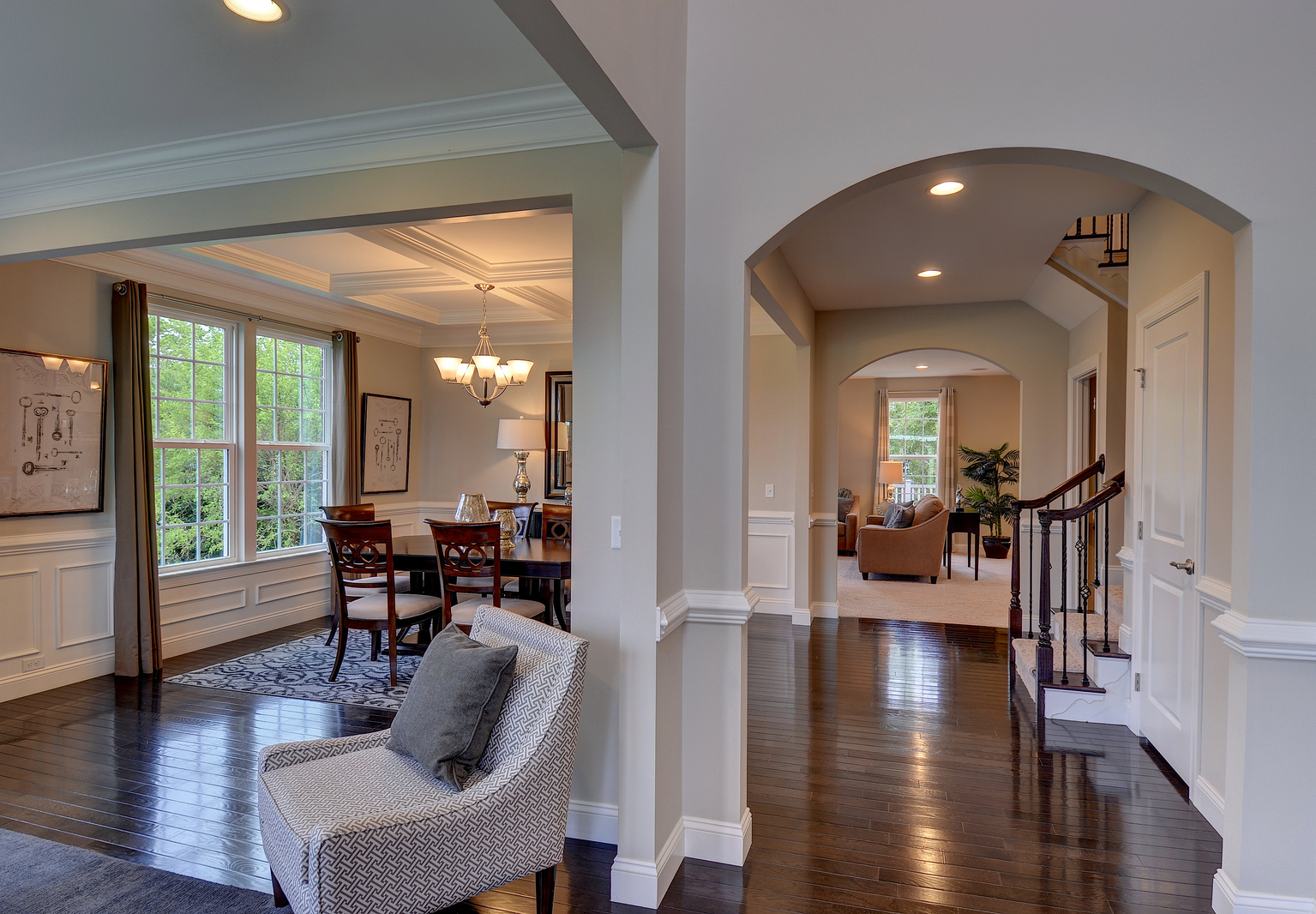 Wrought iron staircase spindles, arched doorways, and stately trim are just a few of the finishing touches to make the floorplan you choose your home sweet home.