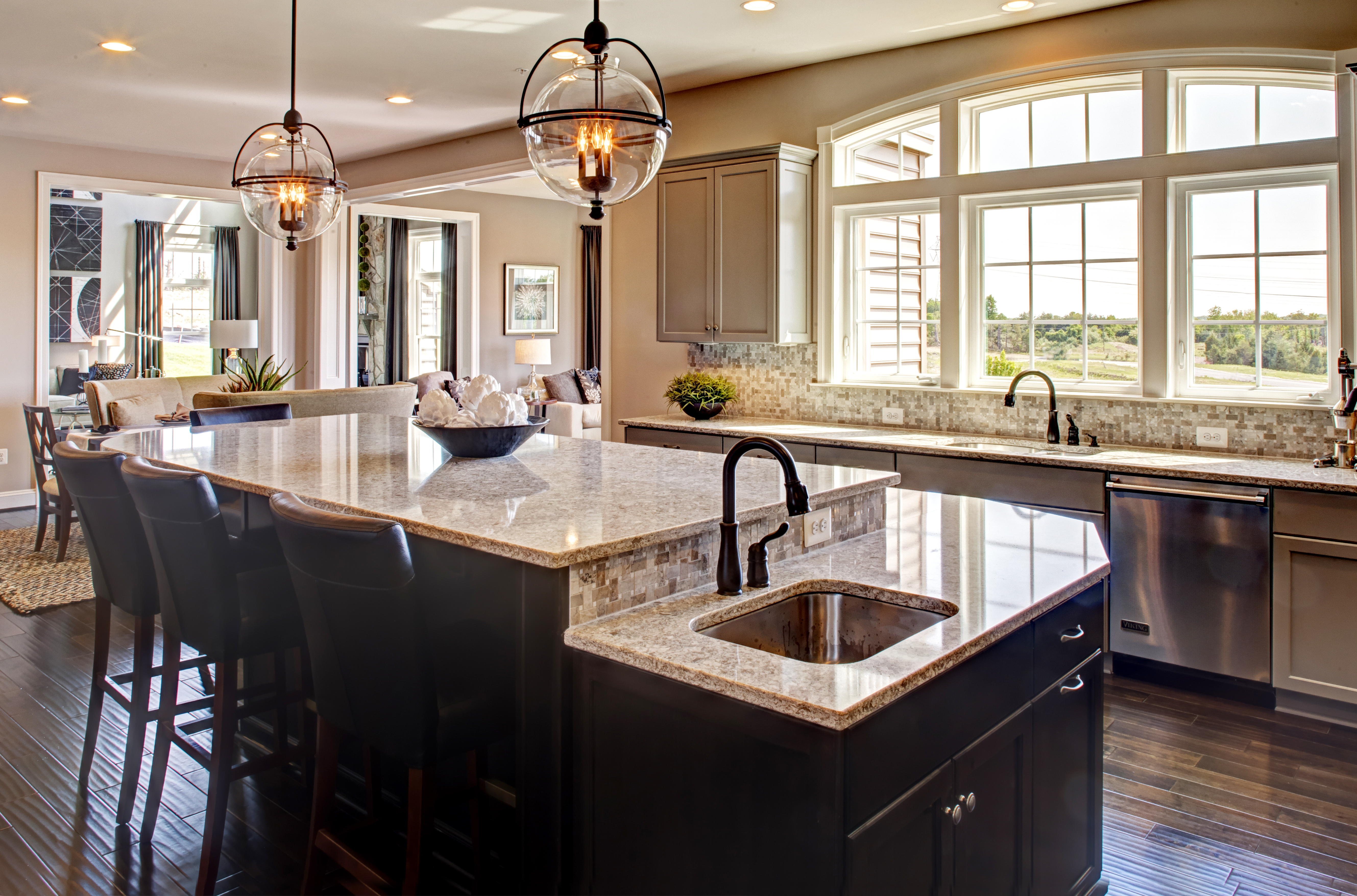 Amateur chefs will find much to love in the designer gourmet kitchen that features stainless steel appliances, an oversized island, granite countertops, built-in cook range and double wall oven.