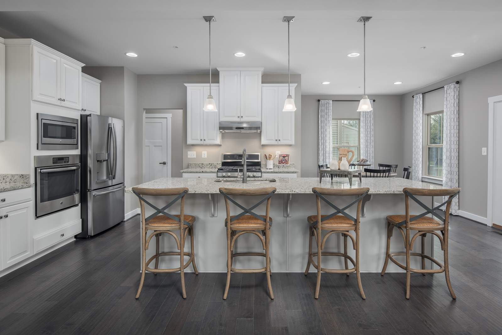 Come by to tour our new and modern designed homes for you in mind. Large open kitchen with designer interiors.