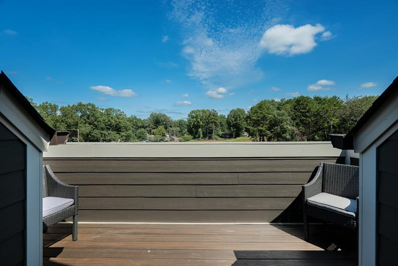 A PRIVATE ROOFTOP TERRACE IS INCLUDED ON THE 4TH LEVEL