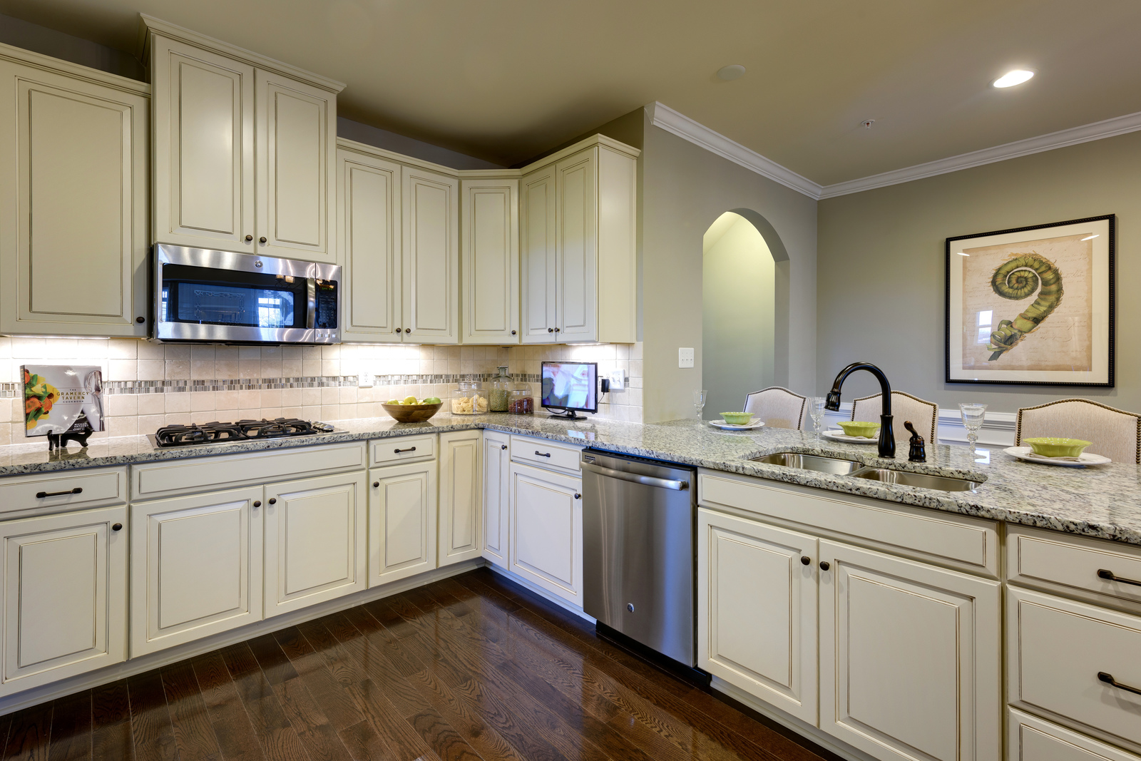 Your gourmet kitchen with custom cabinetry will serve as the perfect place to create delicious dinners
