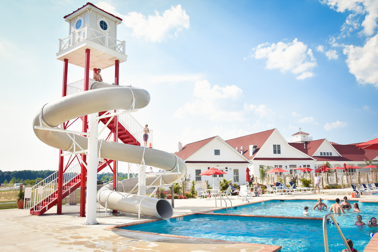 The community pool features fun amenities, like this water slide!