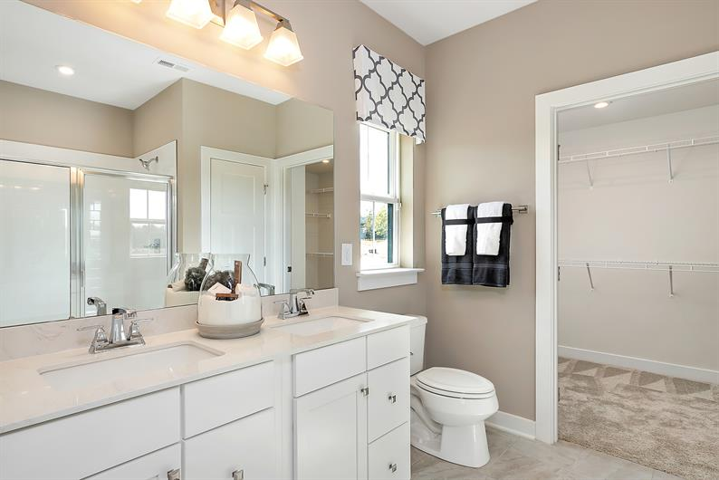 The ensuite bathroom includes a walk in closet and plenty of room for 2