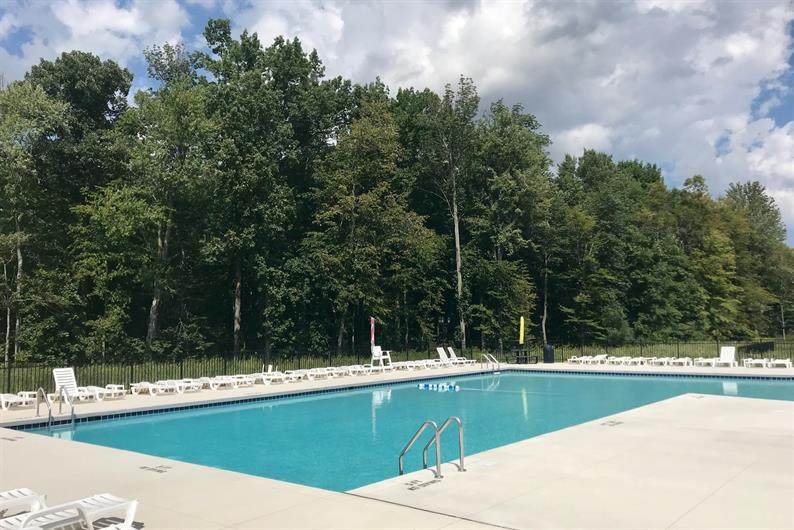 MORE AMENITIES LIKE THE COMMUNITY POOL RIGHT OUTSIDE YOUR DOOR