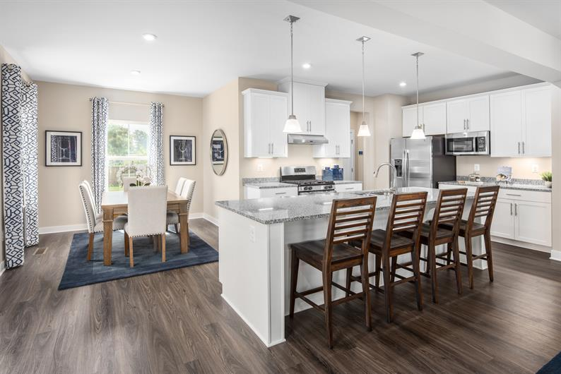 OPEN CONCEPT KITCHENS WITH GRANITE COUNTERTOPS AND MORE LUXURY FINISHES