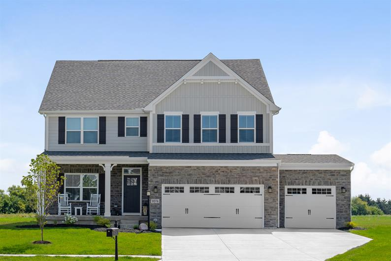 CURBSIDE APPEAL WITH INCLUDED 3-CAR GARAGES PER FLOORPLAN AND STONE AND BRICK DETAILED EXTERIORS