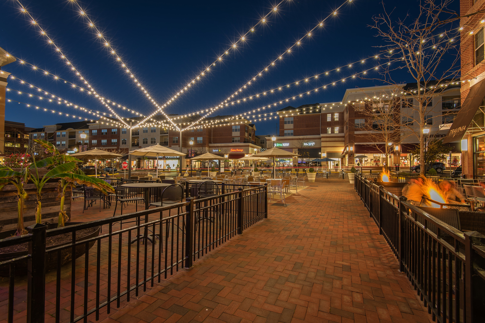 Edison lights hang above the brick-paved sidewalks at Village Walk, where every detail has been considered.