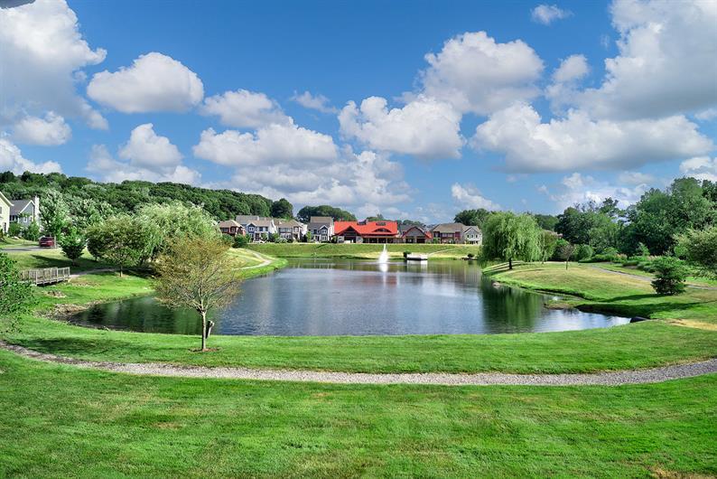 ENJOY WALKING PATHS surrounding the 3 acre COMMUNITY Pond