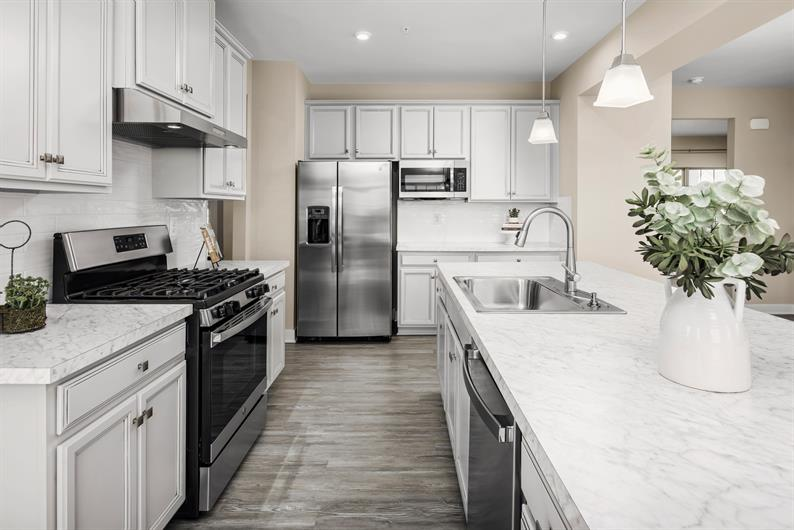 KITCHENS THOUGHTFULLY DESIGNED WITH FAMILIES IN MIND