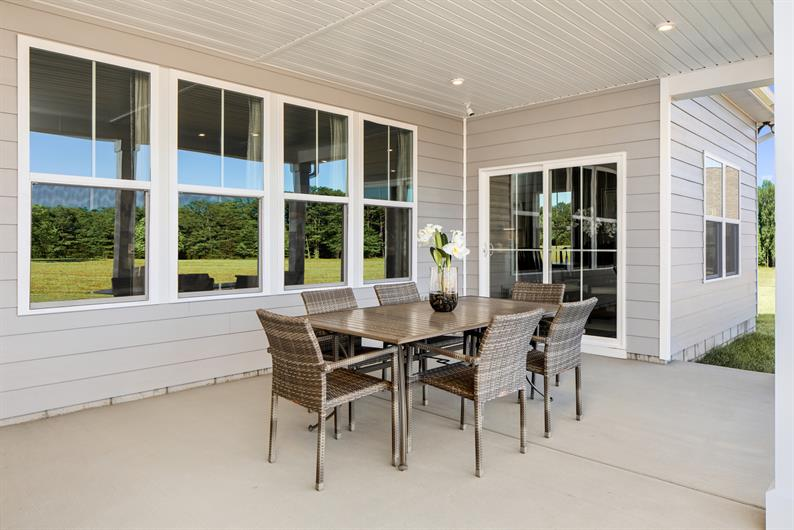 ENJOY THE OUTDOOORS FROM YOUR COVERED PORCH