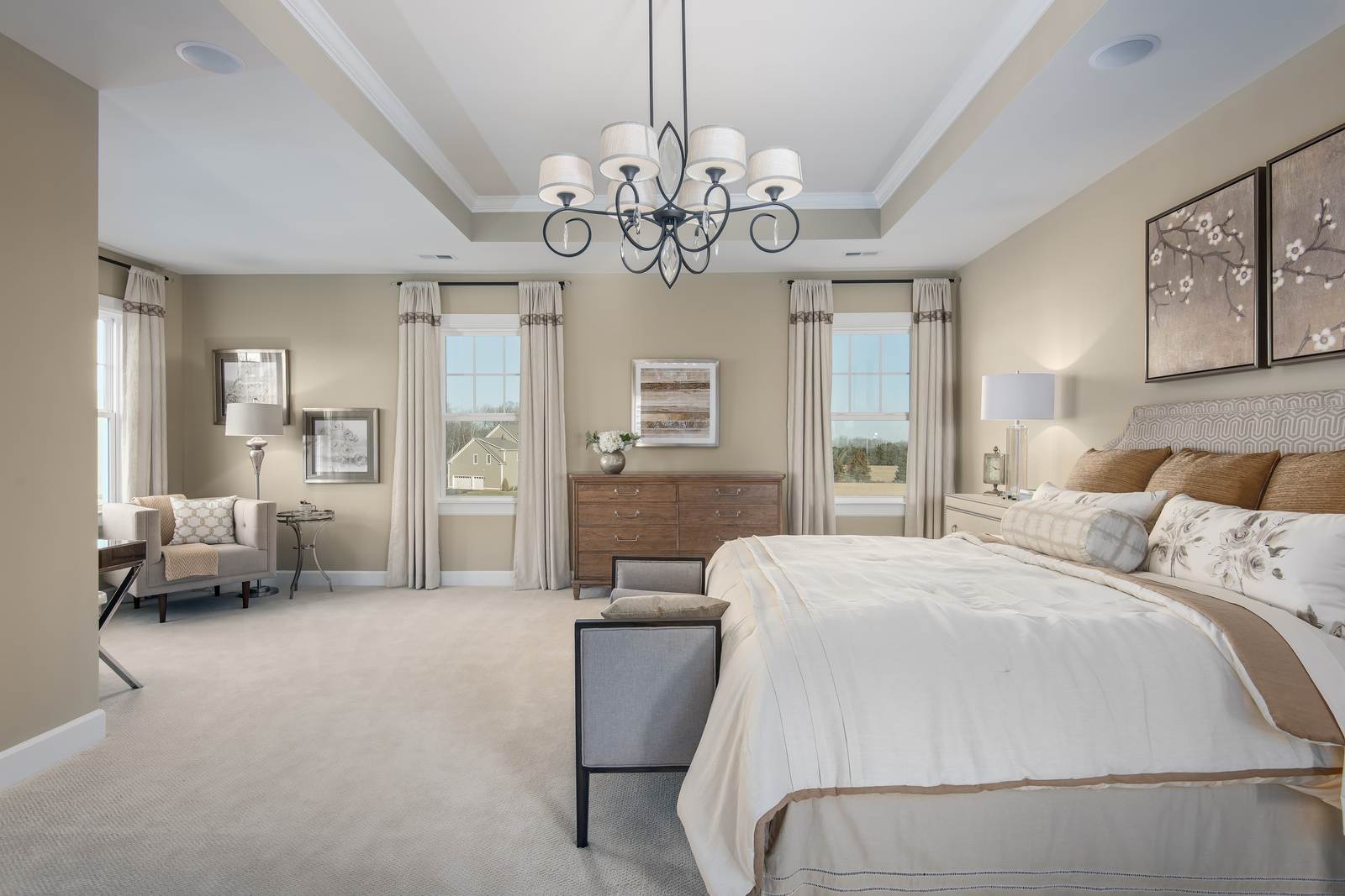 Welcome to an owner's suite worth retreating to. Included tray ceiling, spa bath and dual walk-in closets complete the look.