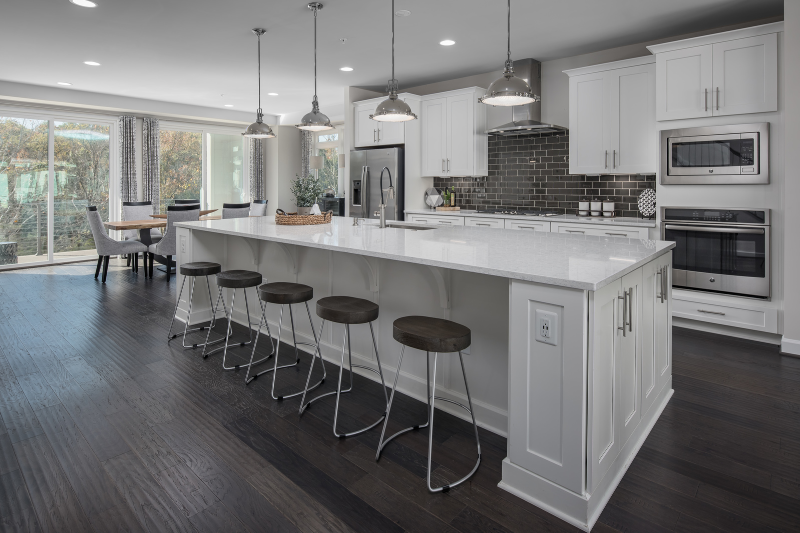 Our designs offer luxury around every corner, like included quartz countertops and hardwood flooring.