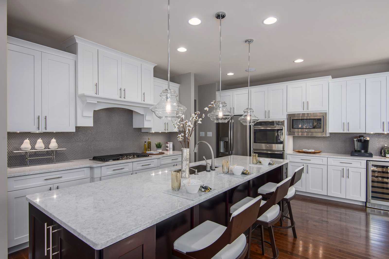 Large open kitchens include granite countertops and hardwood floors.