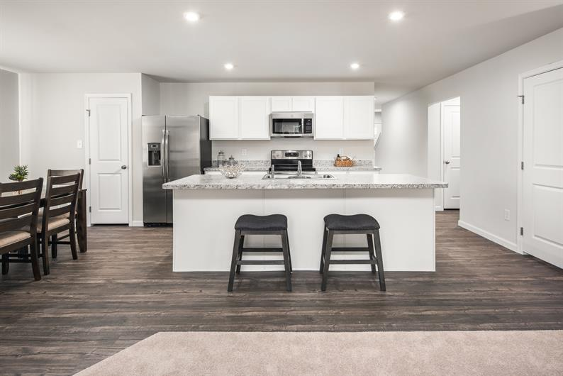 OPEN CONCEPT LIVING WITH ALL THE APPLIANCES INCLUDED and a large island