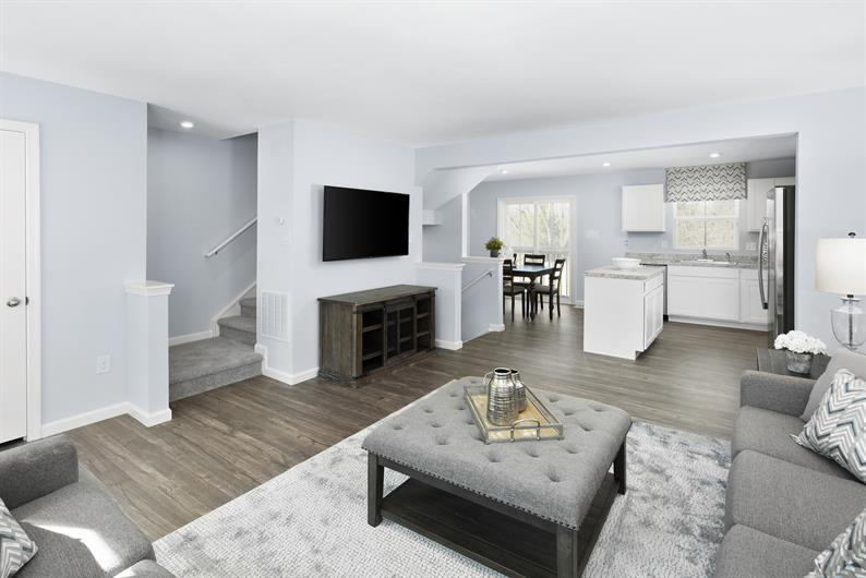 NEVER MISS OUT ON THE ACTION WITH A WIDE OPEN FLOORPLAN