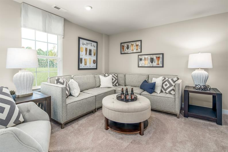 LOWER LEVEL OFFERS MORE SPACE TO ENTERTAIN