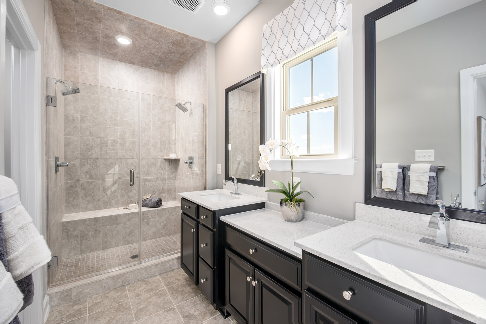 With dual vanities and private water closet, everyone will have their own lavish space.