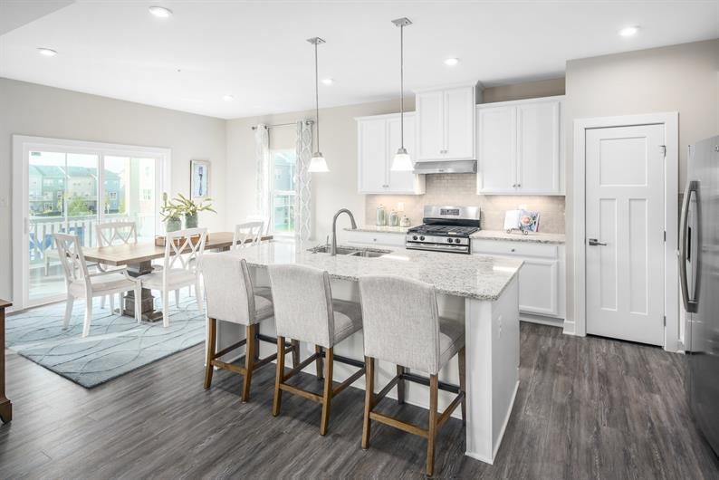 OPEN KITCHENS WITH ISLANDS AND INCLUDED GRANITE COUNTERTOPS