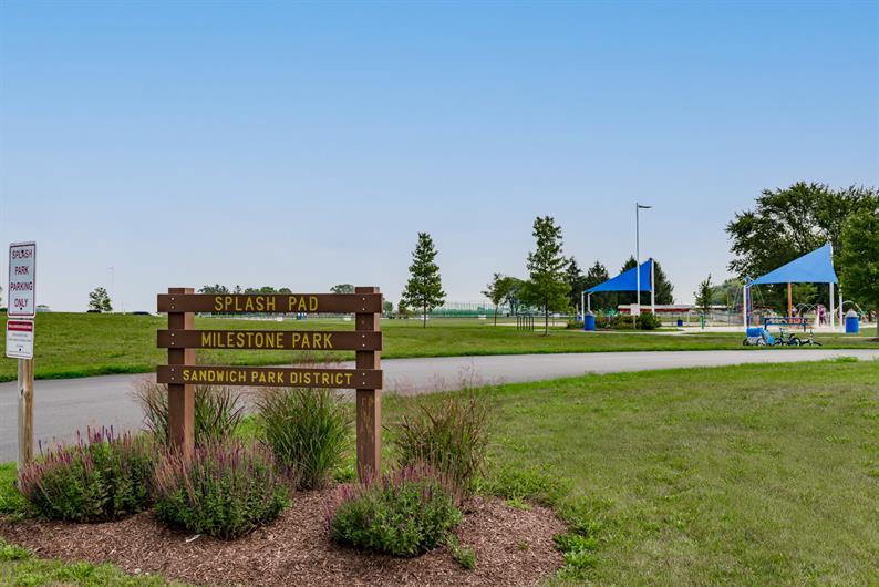 ENJOY AN EVENING WALK ON THE COMMUNITY SIDEWALKS TO Milestone Park