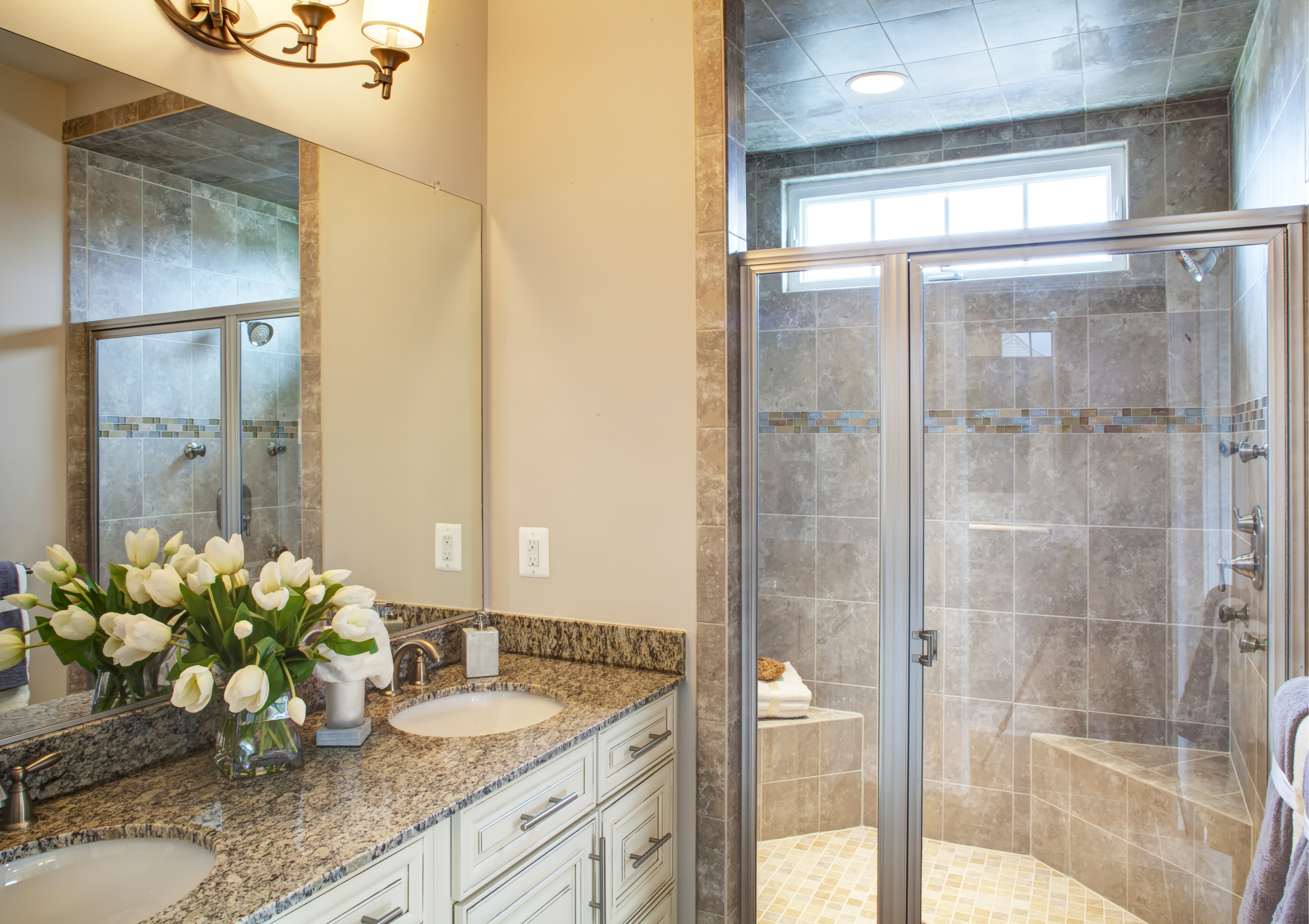 The breathtaking Owner's Bathroom is spacious, luxurious and truly stylish. It is covered with beautiful tile and high-end accessories of your choosing