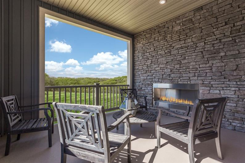 Relax on your covered porch with an outdoor fireplace