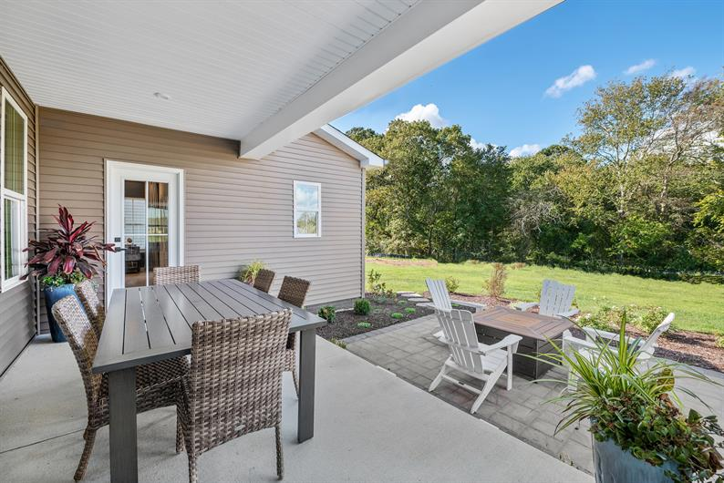 ENJOY HAVING FRIENDS AND FAMILY OVER WITH AN OUTDOOR OASIS BACKING TO WOODED VIEWS