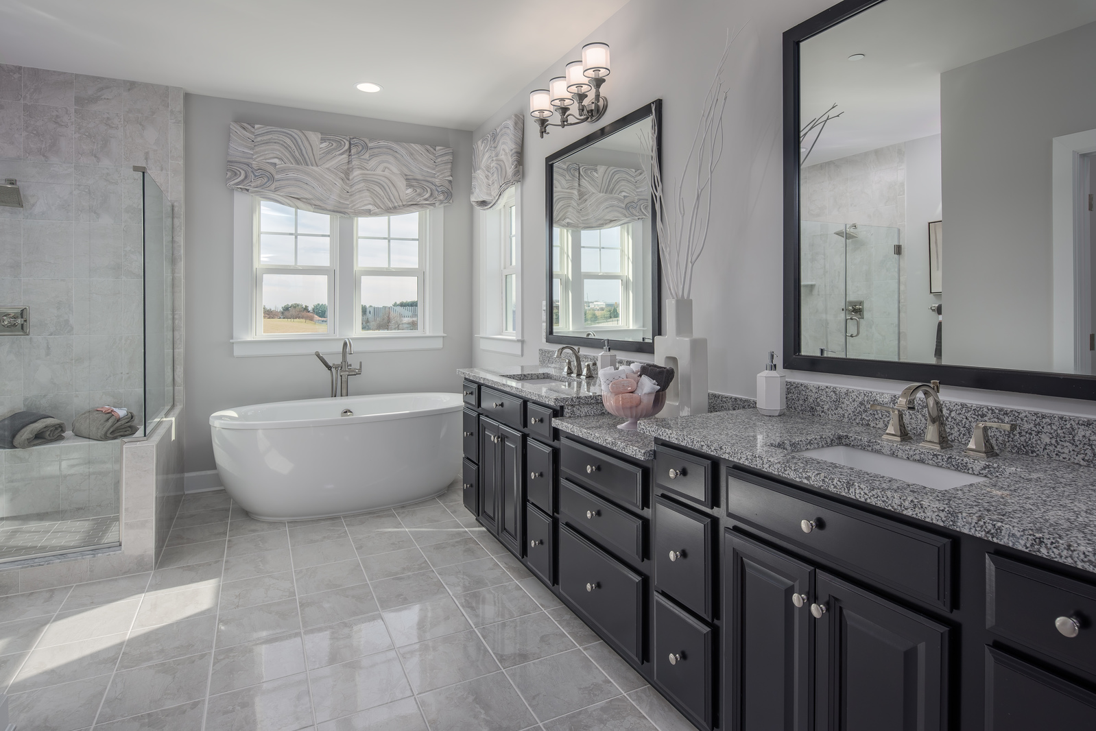 You'll love the oversized ceramic tile, dual granite vanities, and large shower in every home at Chalfont View.