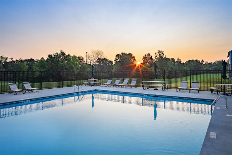 SUMMER FUN AT HOME OR AWAY WITH A COMMUNITY POOL AND A QUICK MILE TO HIGHWAY ACCESS