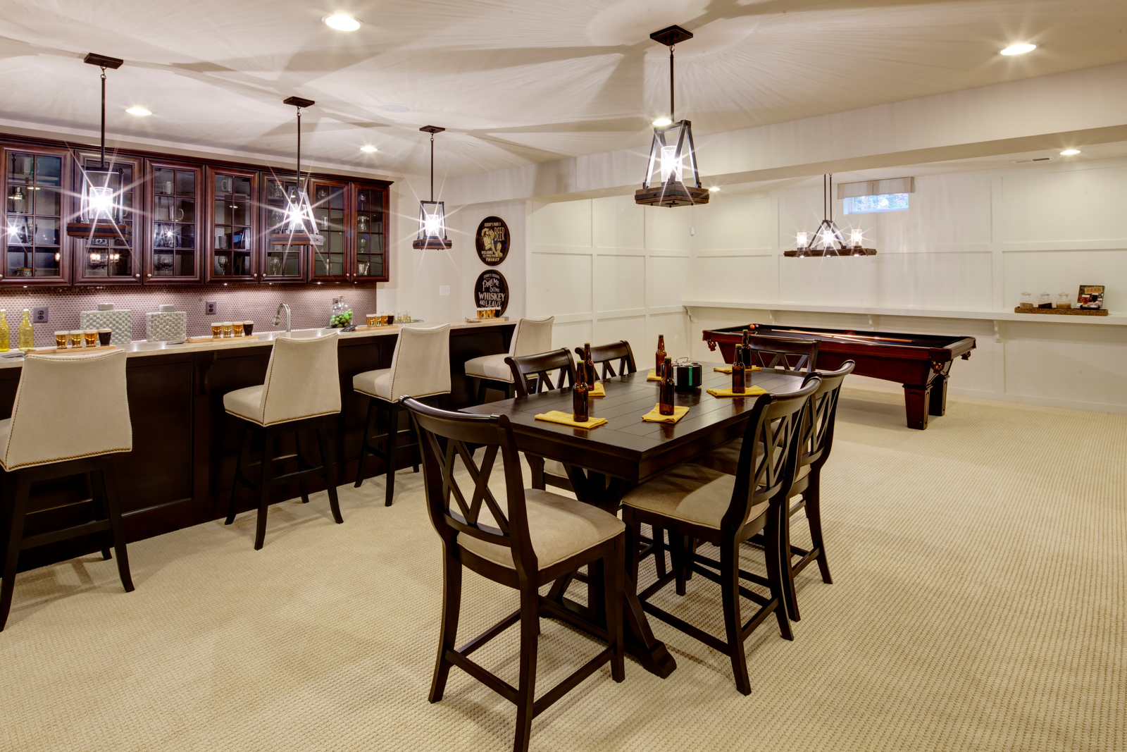 A wet bar adds to the atmosphere for the ultimate basement entertaining space!