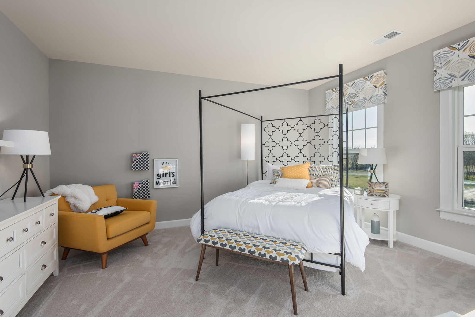 Spacious secondary bedrooms include walk-in closets and private access to baths.