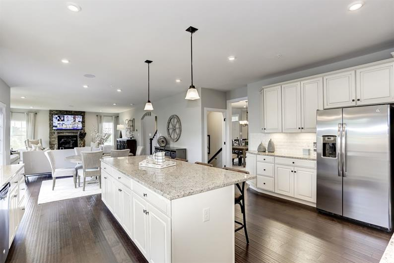 Entertain Your Guests While Cooking Dinner with an Open Kitchen