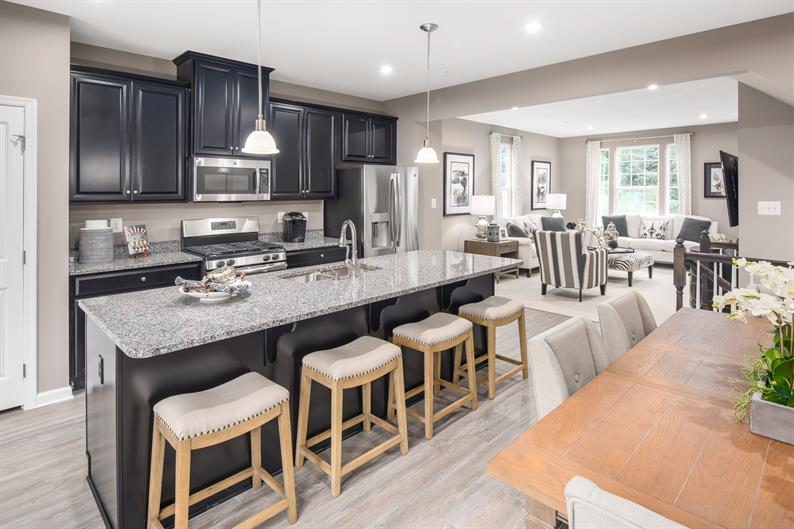 EXPANSIVE ISLAND IN A SPACIOUS KITCHEN