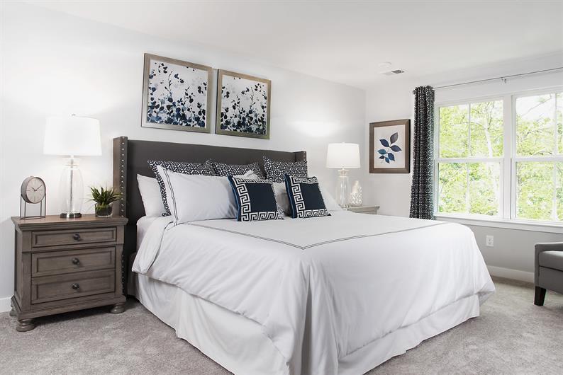 An owner's bedroom fit for a King (size bed)