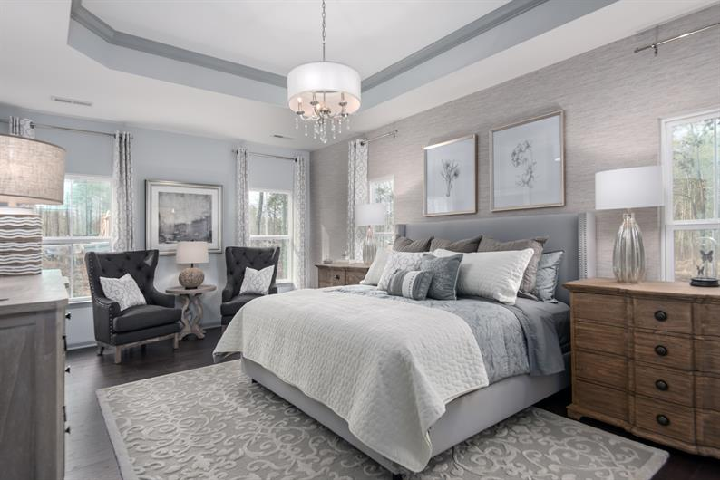 Options for a convenient 1st-floor Owner's suite