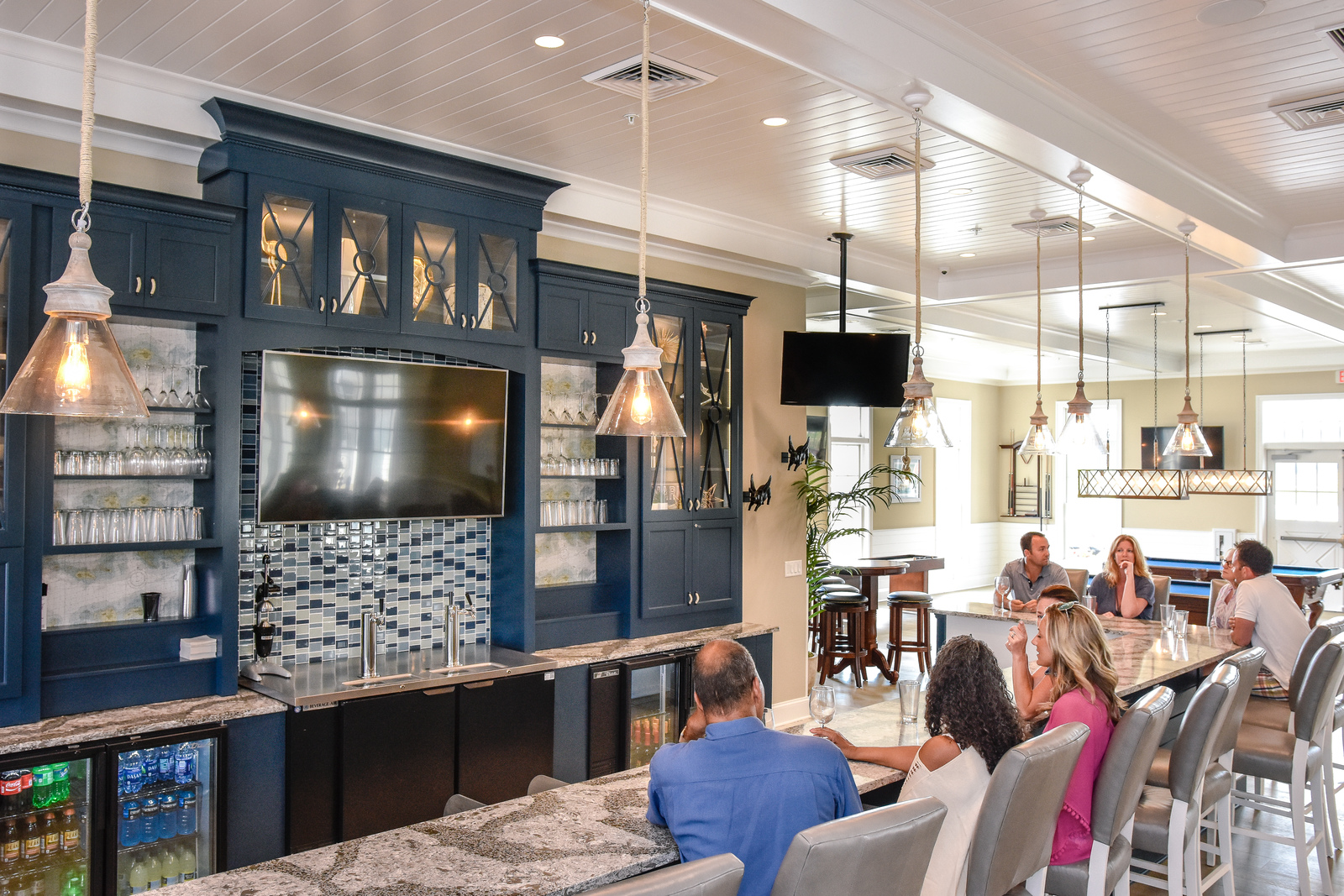 Gather with your new neighbors at the Lighthouse Club bar.