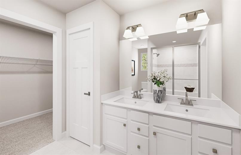 OWNER'S BATH W/ SEPARATE VANITIES, WALK IN SHOWER & SEAT