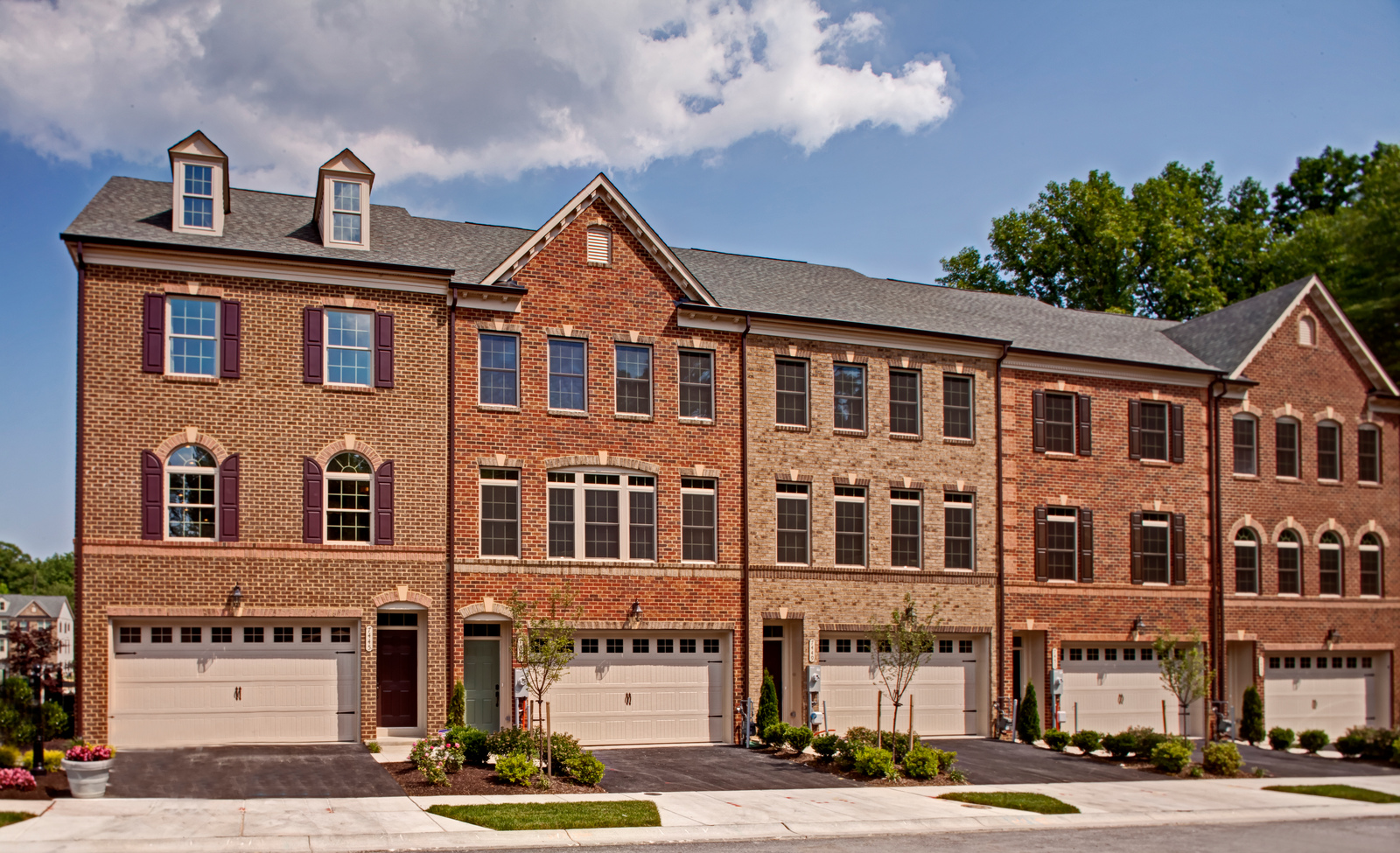 This handsome townhome features a stately elevation, garage parking and ample outdoor living.