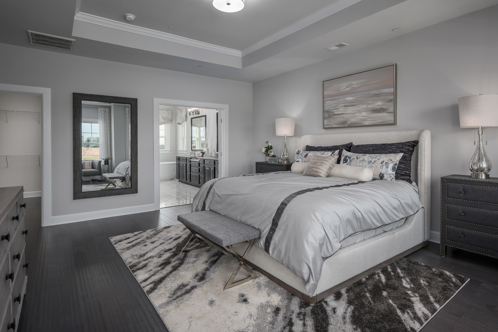 With plenty of space for a King bed, dual closets, and tray ceiling, even oversized furniture feels right at home.