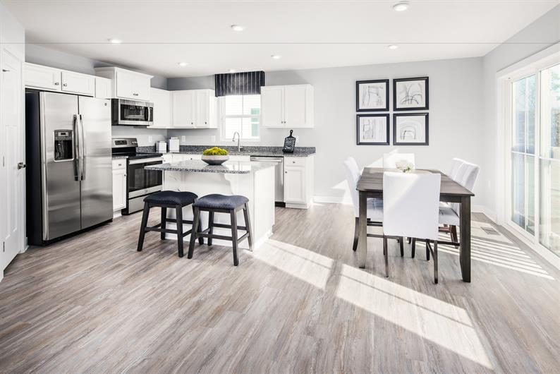 OPEN CONCEPT RANCH LIVING ON WOODED HOMESITES