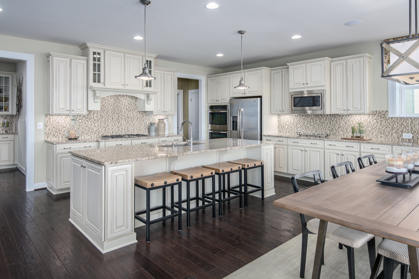 Your bright and airy kitchen at Laytonsville Preserve is a chef's dream. Gorgeous stainless steel appliances perfectly accent the Timberlake cabinetry and elegant tile backslash.